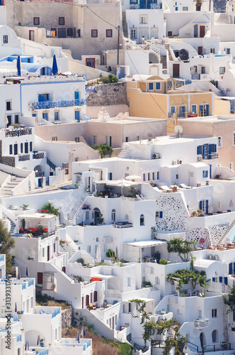 Classic whitewashed Mediterranean hillside view of the village of Oia on the Greek island of Santorini, Greece