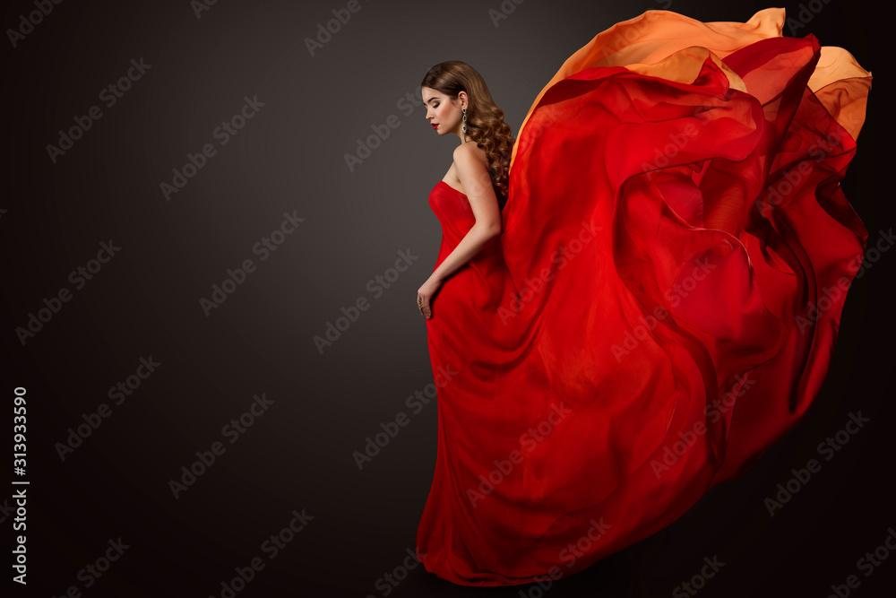 Fototapeta Woman Red Dress Flying on Wind, Beautiful Fashion Model in Fluttering Gown studio Portrait