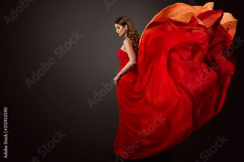 Woman Red Dress Flying on Wind, Beautiful Fashion Model in Fluttering Gown studi Fototapet