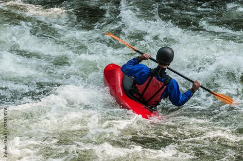 Valokuva man kayaking in whitewater