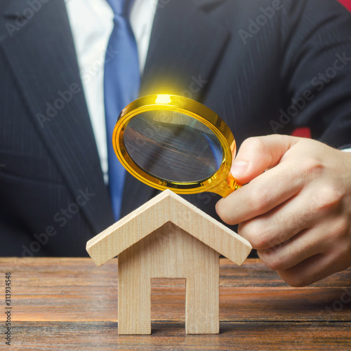 plakat A man is studying a house through a magnifying glass. Fair value of real estate. Property valuation. Legal deal. Standards and quality of construction. Legality and transparency of purchase agreement.