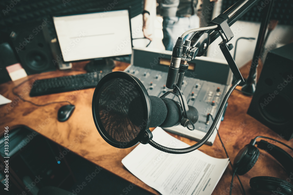 Fototapeta Radio station microphone in recording studio or broadcast room, working place of radio host, close up.