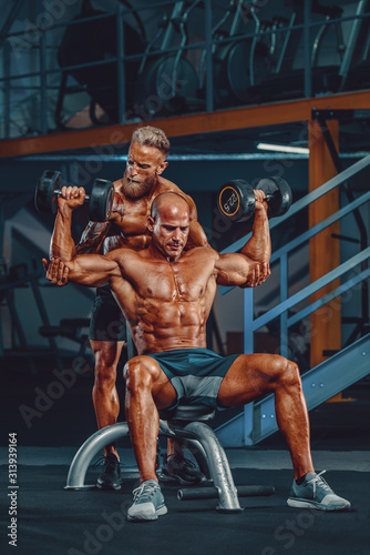 Bodybuilding Hardcore. Two Bodybuilders Train Together at the Gym Slika na platnu