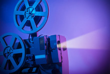 Vintage Old Fashioned Projector In A Dark Room Projecting A Film