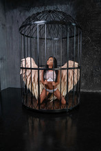 Angel Girl Locked Up In A Steel Cage
