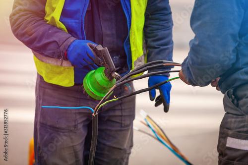 Valokuvatapetti Electrical network and street light pole repair using heat shrink tubing