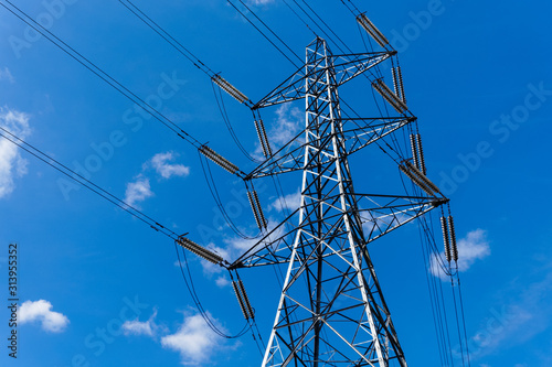 Fotografie, Obraz Electricity pylon with blue sky