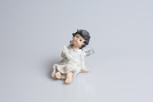 Little Girl Figurine On A Whit...