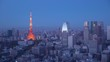 Japan, Tokyo, city skyline with Tokyo Tower and Mount Fuji beyond