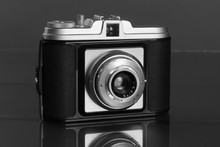 Old Retro Photo Camera On Dark...