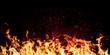 Leinwandbild Motiv flames of fire on a black background