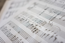 Handwritten Sheet Music On Clean White Paper