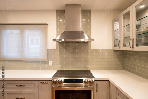 New and Modern Open Concept Kitchen with a Grey and White Color Scheme Canvas Print