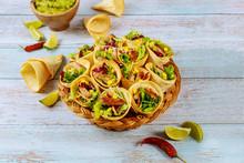 Stuffed Tortilla Cones With Fajita On Wicker Basket With Lime And Guacamole.