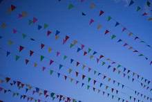A Row Of Small Flags Fluttering In The Wind