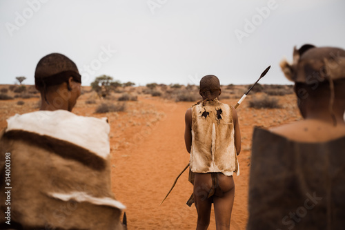 Photo original native bushman from Namibia with traditional clothing from behind