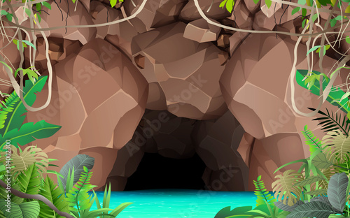 Photo landcape of the cave at the river in the jungle