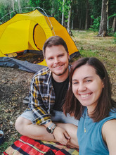 Couple Taking Selfie Picture Sitting Outdoors Tent On Background