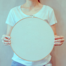 Girl Holding Round Frame, Wooden Frame, Embroidery Hoop For Stretching Fabric In Embroidery Or Silk, Or May Mean The Wooden Frame For The Fabric To Be Sewn Into A Robe.Concept For Handmade.Copy Space.