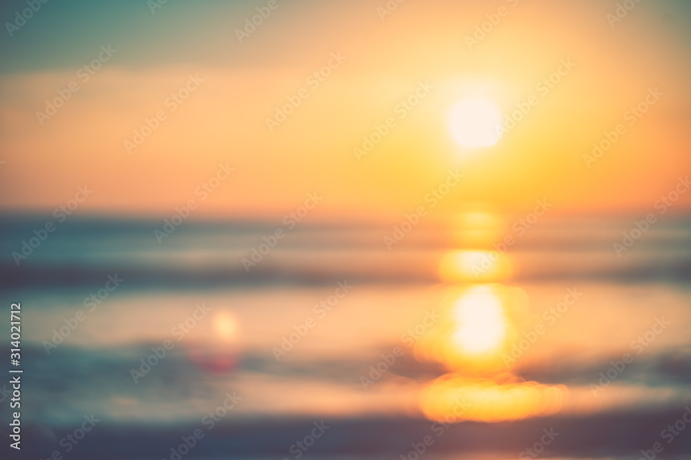 Fototapeta Copy space of soft sand sea and blur tropical beach with sunset sky and cloud abstract background.