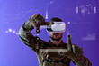 canvas print picture soldier using  virtual reality headset purple background