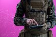 canvas print picture soldier using tablet computer closeup pixelated