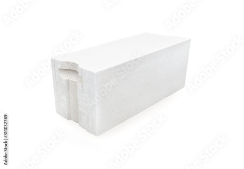 Photo White foamed lightweight concrete (aerated concrete block) isolated on white background