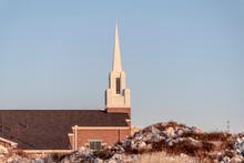Small Modern Church With White Steeple Near Sunrise