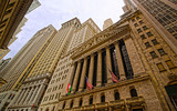 Street view of New York Stock Exchange, or NYSE, on Wall Street in Financial District of Lower Manhattan, New York of USA. Skyline and cityscape with skyscrapers at United States of America, NYC, US