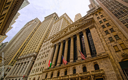 Street view of New York Stock Exchange, or NYSE, on Wall Street in Financial District of Lower Manhattan, New York of USA. Skyline and cityscape with skyscrapers at United States of America, NYC, US - 314045118
