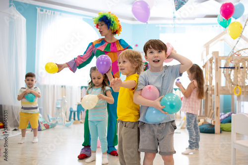 Clown entertains kids at children's party in club