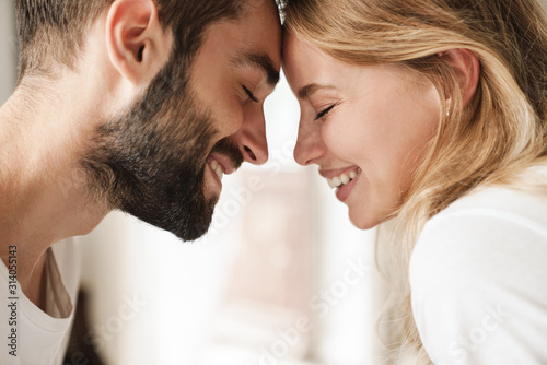 Close up of a beautiful happy young couple relaxing