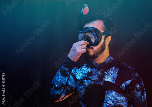 Scuba diver trying to equalize presure on the depth Canvas Print
