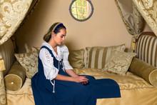 Woman In Golden Renaissance Bedroom