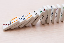 White Dominoes Stand In A Row ...
