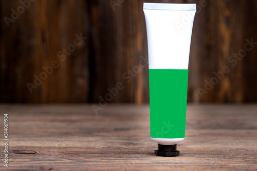 male aftershave cream on wooden background, close-view Wallpaper Mural