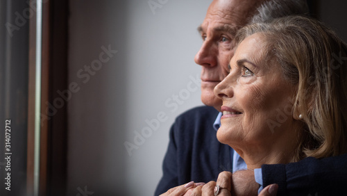 Stampa su Tela  A lovely senior couple is enjoying their time together and showing their love to each other at home