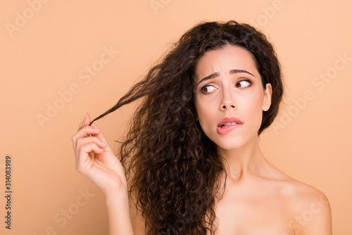 Fototapeta Close-up portrait of her she nice attractive lovely nervous depressed frustrated wavy-haired girl touching showing medicine curls disaster isolated over beige pastel background obraz