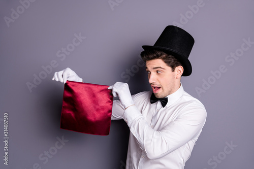 Funny funky magician start his wonderful focus hold hand red napkin look say abr Canvas Print