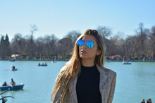 Young Woman Wearing Sunglasses...