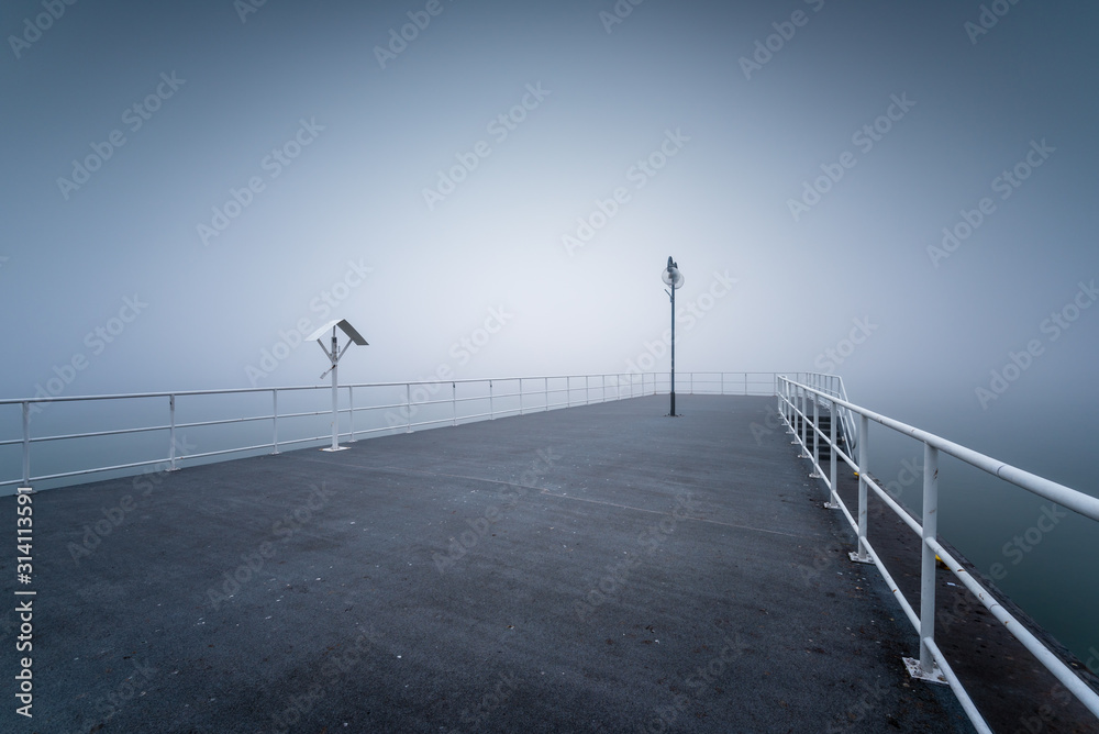 Fototapeta Wooden jetty by the sea on a foggy morning. Baltic Sea Gdynia, Poland