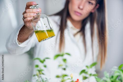 Fototapeta Homeopathy. Homeopath preparing herbal remedies obraz