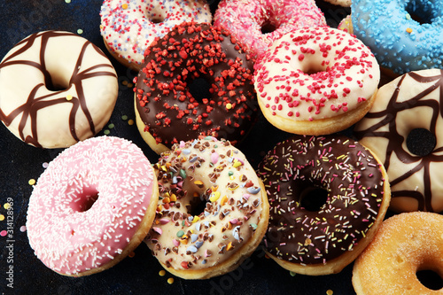 assorted donuts with chocolate frosted, pink glazed and sprinkles donuts - 314128969