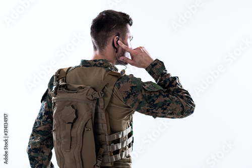 soldier preparing gear for action and checking communication Fototapeta