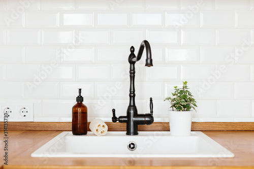 Fotomural Kitchen with white sink and black faucet wooden countertop