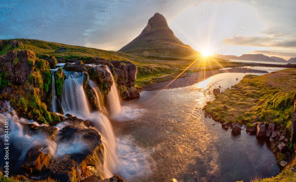 Obraz Beautiful landscape with sunrise on Kirkjufellsfoss waterfall and Kirkjufell mountain, Iceland, Europe. fototapeta, plakat