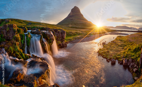 Obraz Beautiful landscape with sunrise on Kirkjufellsfoss waterfall and Kirkjufell mountain, Iceland, Europe. - fototapety do salonu
