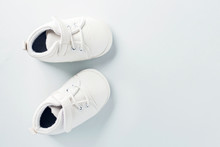 Tiny Baby Shoes On Pastel Back...