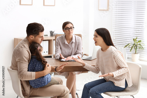 Professional psychologist working with family in office