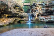Scenic Waterfall Under Bridge ...